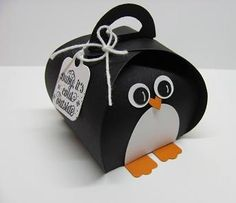 2014  make a penguin with the Curvy Keepsake Box Thinlit. used the Owl Builder punch for the eyes and beak, the Extra Large Oval for the belly, and the modern label for the feet.