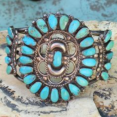 Southwestern Zuni-style rosette cluster bracelet set with blue natural…
