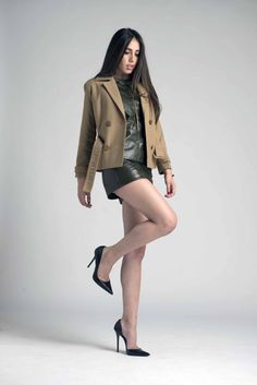 Wool coat with wood buttons. Set of leather top and shorts. Designed by MARIA ROVIRA.