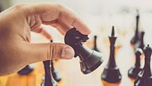 Hand moving chess piece
