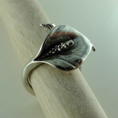 Calla Lily Ring, Unique Adjustable Calla Lily Ring in Sterling Silver, Adjustable Ring, Flower ring, silver ring, Calla Lily Jewelry, by DawnVertreesJewelry on Etsy https://www.etsy.com/listing/189808125/calla-lily-ring-unique-adjustable-calla