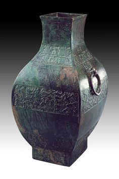 """Fang vessel with hunting scene design,  early Warring States period, circa 5th-3rd century BC.  The Shang and Chou dynasties saw the height of the magnificent Bronze Age when costly bronze vessels were made exclusively for nobility. The saying, """"Ritual and warfare are the most important affairs of state,"""" captures the importance of bronze ware in this age when bronze was cast into both weaponry and ritual implements for sacrificial offerings to ancestors."""