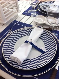 Blue place setting could be used in a nautical theme.