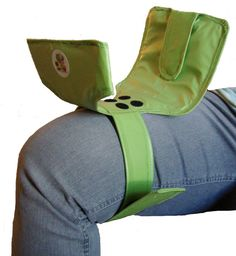 Green portable toddler standing diaper changing pad by SwiftySnap, $39.95