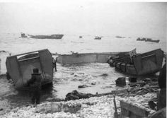 3 LCVP's from the USS Anne Arundel washed up on the shore of Omaha Beach during a storm on June (Photo is part of the National Archives and can also be found in the book, The Americans on D-Day by Morgan). Battle Of Normandy, D Day Normandy, Normandy France, Ww2 Pictures, Ww2 Photos, Oral History, Us History, Family History, D Day Landings