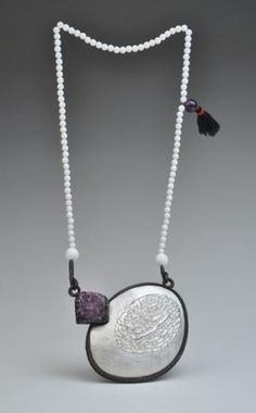 Mengnan Qu, Bitter Unders the Skin. Fine silver, copper, chasing  repousse, electro formed, amethyst, shell.