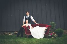 Bride and Groom on Red Velvet Couch | photography by http://onesummerdayphoto.com