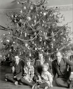 """Modern Family: """"Dickey tree, 1914."""" Christmas visit with the family of Washington lawyer Raymond Dickey, whose portraits mix equal parts Chekhov and Addams with a dash of Dickens. National Photo Company glass negative. Click to view full size."""