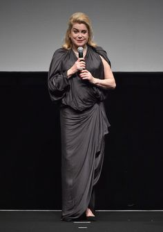 """Catherine Deneuve Photos Photos - Actress Catherine Deneuve speaks on stage as she receives a Lifetime Achievement award during the Opening Night Gala of """"Room"""" on day one of the 12th annual Dubai International Film Festival held at the Madinat Jumeriah Complex on December 9, 2015 in Dubai, United Arab Emirates. - 2015 Dubai International Film Festival - Day 1"""