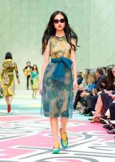 A printed tulle dress with Burberry butterfly shades and field sneakers