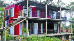 multi-tiered shipping container home with decks