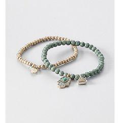 Nine West Vintage America Collection® Set of Two Green Beaded & Antique Goldtone Stretch Bracelets at www.herbergers.com