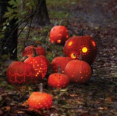 Impress the whole neighbourhood with a pumpkin patch of jack-o'-lanterns with various sizes of drilled holes. #diy #halloween #pumpkins