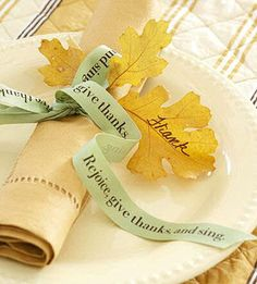 Personalized ribbons wrap up these napkins for Thanksgiving and the leaves make place cards.
