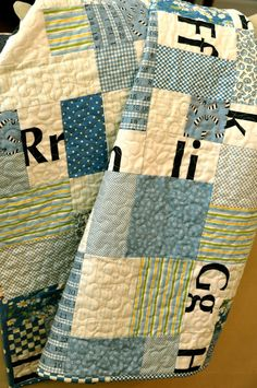 Easy quilt with boyish fabrics. I like the letters and numbers.