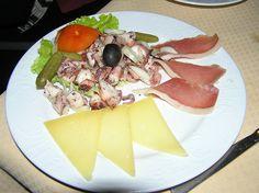 My favorite Croatian food: octopus salad, dalmatian ham, and cheese