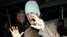 Bleary-eyed Footballer Joe Cole was seen stumbling out of a nightclub.
