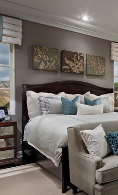 bedroom design....love the art above the headboard!