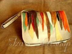 Hand-crafted purse made of marbled, brown and gold genuine leather, decorated with some rivets. One inside pocket and a magnetic closure. Approx Dimensions: Width : 8 1/2 inch (22 cm) Length : 9 1/...