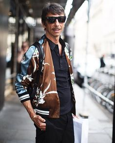 "Spotted on the street in Paris one of the most stylish men I know Pier Paolo Piccioli (also know as one half of the design duo that masterminds Valentino @maisonvalentino) whenever we have a chance to chat it always gets around to being Dads and our kids! We both laugh that our kids use to ask us not to pick them up at school wearing our ""fashion clothes"""