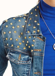 Denim jackets are one of our favorite things right now, but throw on a few studs? Perfection.