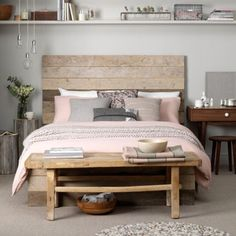The shelf above the bed. ..maybe on my corner above bed Reclaimed timber planks make up this bed frame and headboard to provide a rough-and-ready coastal vibe. The look, decorated in shades of grey, off-whites, dusty pinks and browns, is completed with sisal flooring and nubbly rugs. Via: Housetohome