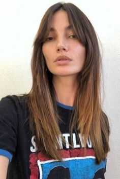 Lily Aldridge wearing Isabel Marant Silver Nirvana Earrings and Saint Laurent Printed Cotton-Jersey T-Shirt