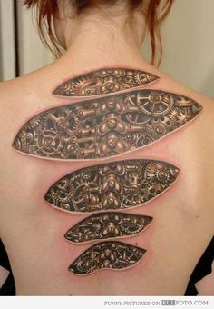 What makes me tick - Cool tattoo of 3D mechanical parts under the skin looking like clock wheels that makes her tick.