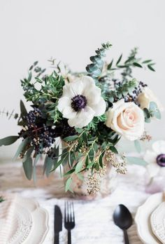 Flower arrangement with anemones, seeded eucalyptus, feather eucalyptus, gunni eucalyptus
