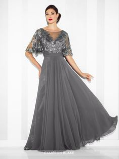 117622 - Chiffon A-line gown with illusion bateau neckline and sequin lace illusion elbow-length flutter sleeves, sequin lace accented V-bodice, finely ruched waistband, V-back, center gathered skirt.