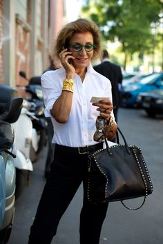 Classic and very cool.  And look at what makes the outfit: the cuff and the handbag!