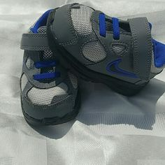 Infant Nike Like new condition. Only worn once indoors. Grey and periwinkle. Cute for boy or girl. Infant size 5. Nike Shoes Sneakers