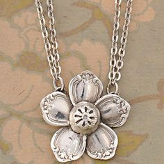 Flower necklace made from recycled silverware.