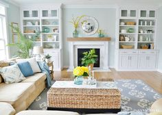 Take a spring family room and kitchen tour all decked out in soft shades of blue and pops of cheerful yellow and lush botanicals.