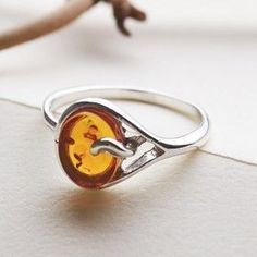 This simple yet refined honey amber ring is a perfect combination of modern fashion and affordability. Look great while not breaking the bank with this authentic Baltic amber ring set in sterling silver. Due to the fact that amber is a naturally occurring Amber Ring, Amber Jewelry, Bohemian Jewelry, Stone Jewelry, Amber Fossils, Amber Gemstone, Stone Pictures, Natural Honey, Diy Jewelry Making
