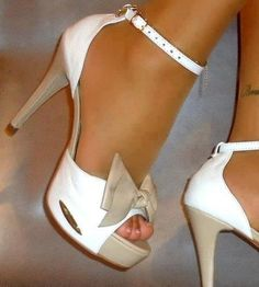 Towering shoes and high heels that look sexy....minus the bow