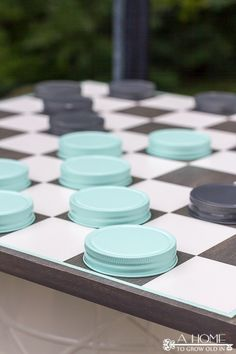 Giant Checkers Game from Mason Jar Lids diy oversized checkerboard game, diy, outdoor living, woodworking projects Mason Jar Lids, Mason Jar Crafts, Jar Lid Crafts, Giant Checkers, Outdoor Checkers, Wood Projects, Woodworking Projects, Woodworking Plans, Woodworking Shop