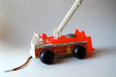 Vintage Fisher Price Fire Engine Pull Toy, Nursery Decor by MilleBebe on Etsy https://www.etsy.com/listing/196780592/vintage-fisher-price-fire-engine-pull
