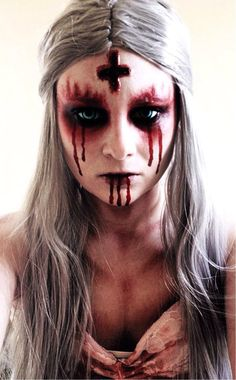 demented nun makeup with saw white contacts possessed