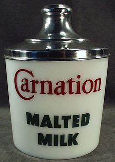 Carnation was bought out by Nestle....I have this exact malted milk container....bought it in an antique store in Missouri a few years ago....