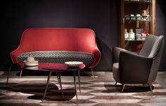 Draga & Aurel   Sofas. Pink sofa, seat is dotted black and white