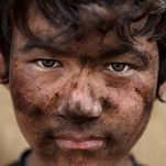a nepalese boy working in a coal mine in northeast india