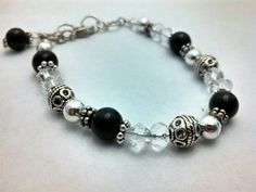 Black and crystal glass beads  with a variety of metal spacers. Adjustable clasps with bead dangle charm.