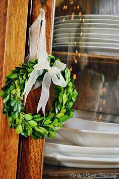 mini boxwood wreath hanging on cabinet All Things Christmas, Christmas Home, Vintage Christmas, Christmas Wreaths, Christmas Decorations, Holiday Decor, Holiday Ideas, Christmas Ideas, Xmas