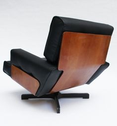 M. Taro; #401 Molded Rosewood Laminate and Enameled Metal Lounge Chair for Cinova, 1964.