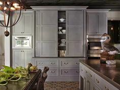 LOVE those huge sliding cabinet doors by Greige Design