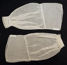 Undersleeves - 1860's, American, cotton. Interesting how they have a smooth band at the top, to which the gathers are attached, rather than going all the way to the top.