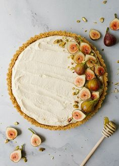 Honey Mascarpone Tart By The Wood and Spoon Blog by Kate Wood. This is a simple, summer dessert. A no-bake cheesecake tart of sorts with a salty press in graham cracker and a creamy cheese filling. The tart is naturally sweetened with honey and is topped with toasted pistachios and fresh figs. This dessert can be made ahead and is quick- it takes less than 30 minutes of prep time. Make this little tartlet in place of summer pies. Find the whole recipe and photos on thewoodandspoon.com