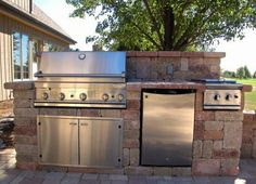 Patio and Outdoor Kitchen with walls featuring Unilock Olde Quarry paver Bbq Grill Island, Built In Bbq Grill, Outdoor Kitchen Patio, Outdoor Decor, Outdoor Kitchens, Barbecue Area, Outdoor Cooking, Building, Landscaping Ideas