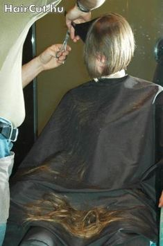 hair falling in lap while going for a nice short haircut.